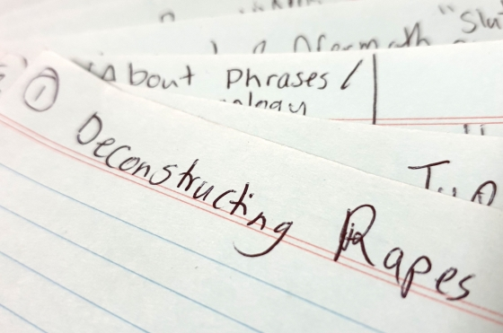 Index cards fanned out. The top card reads Deconstructing Rapes. The number one is circled and in the top left hand side.
